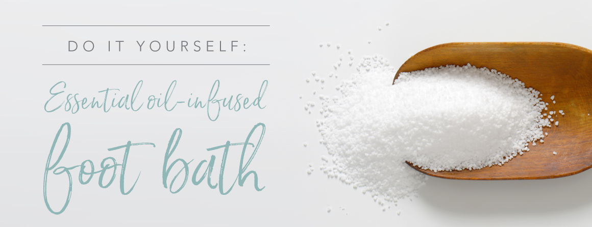 Do it yourself essential oil infused foot bath. Epsom salt in a scoop on a white background