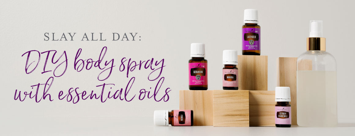 essential oils used for a DIY body spray recipe standing on wooden blocks