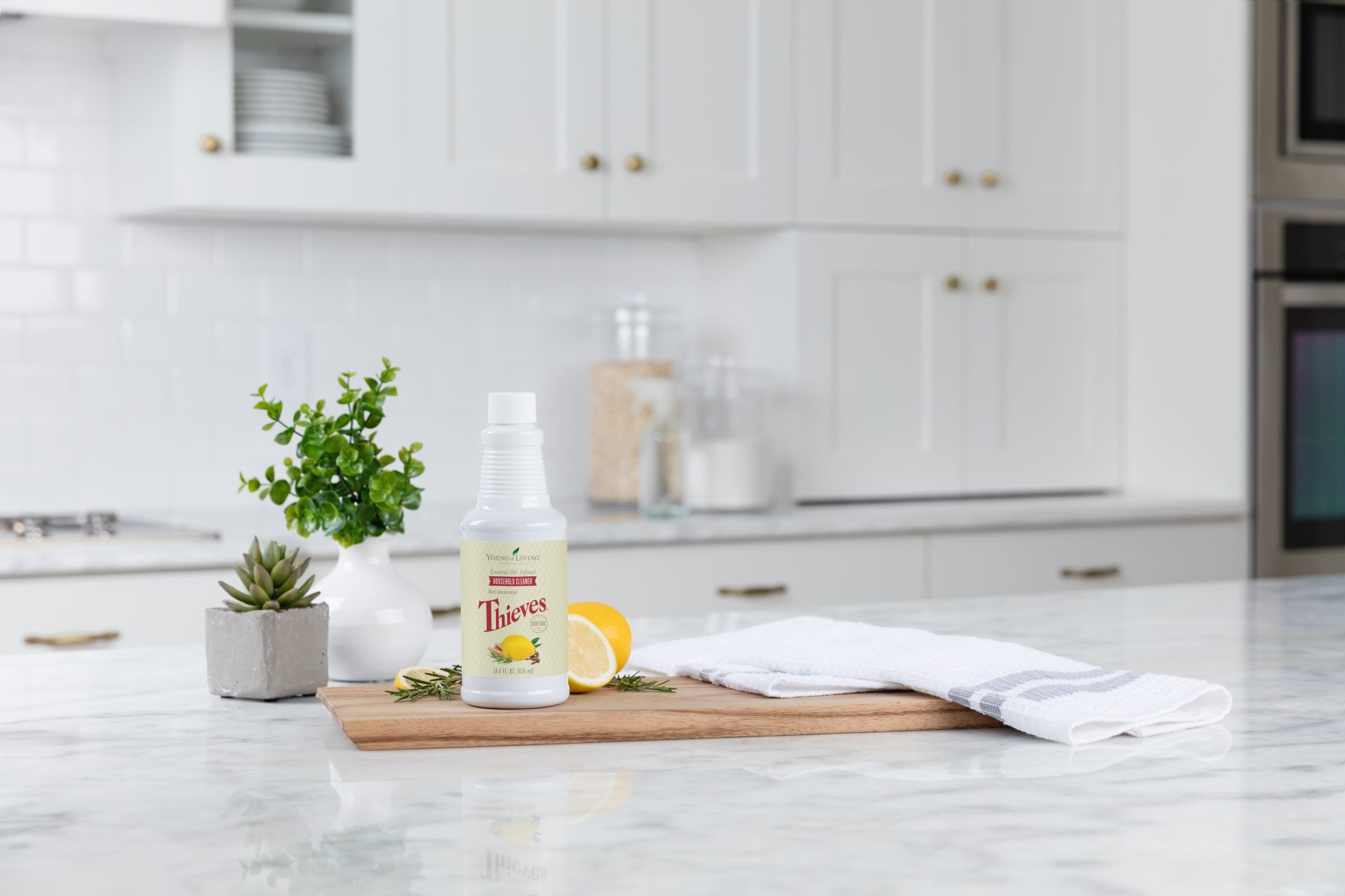 Thieves household cleaner on a marble kitchen counter