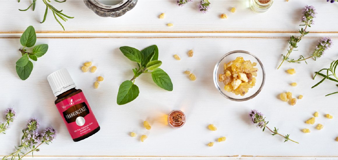 Frankincense essential oil on a table top with botanicals for grounding and mindfulness