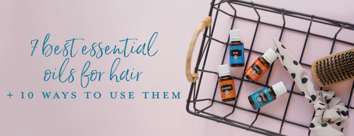 Essential oils in a wire basket on a blush background- Essential oils for hair