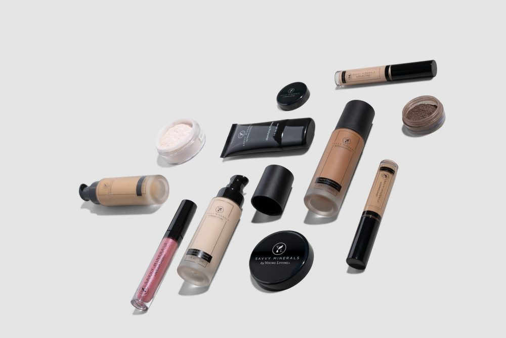 foundation, concealer, powder, and other makeup products arranged on a clean background