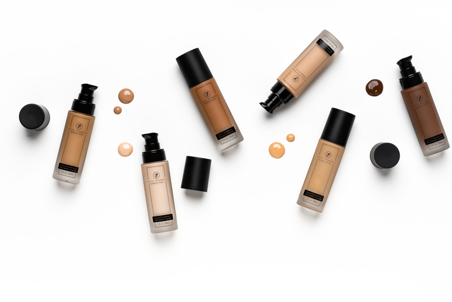 liquid foundation in different shades on a white background