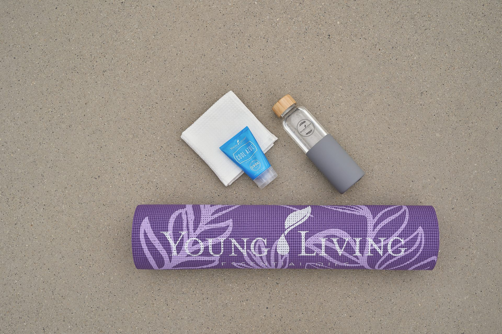 Yoga mat, bottles, and cooling cream
