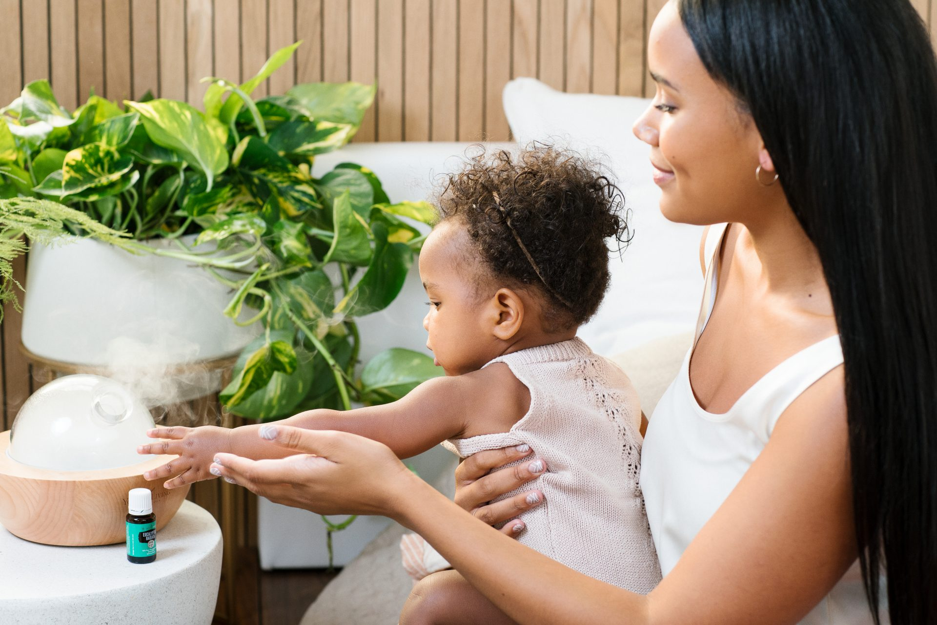 Young Living essential oil diffuser with a Mom and Baby