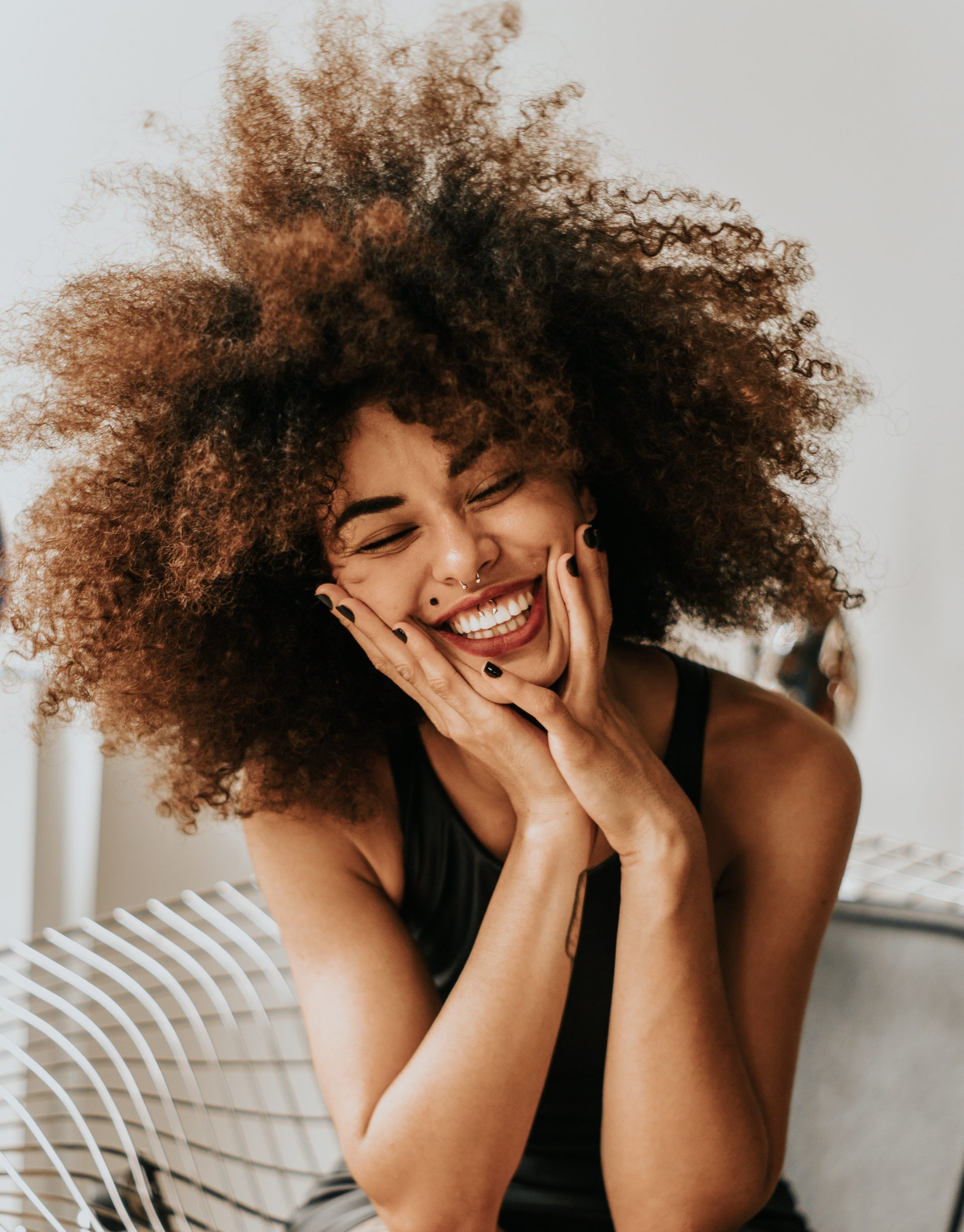 Woman smiling - Photo by Guilherme Almeida from Pexels - Young Living Lavender Life Blog